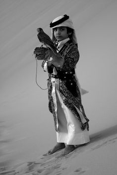 little Arab boy with falcon in the desert...