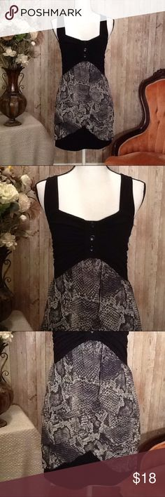 Summer Dress Rue 21 Size Medium Black White Super cute dress by Rue 21, size Medium, like-new condition, black, white with silky snake skin pattern, form fitting style, straps have two buttons for length adjusting, slip on for easy fit, shorter style dress. Approx length from top to bottom, 30 inches, length from bottom of strap to bottom of dress, 25 inches. Perfect for spring and summer! Rue21 Dresses Mini