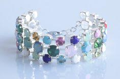 Beautiful three strand multicolored bracelet made by wcubeddesigns, $245.00