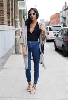 With a long cardigan and sandals