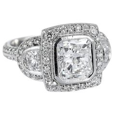 2.11 Carat GIA Cert Color Radiant Diamond Platinum Ring | From a unique collection of vintage engagement rings at https://www.1stdibs.com/jewelry/rings/engagement-rings/