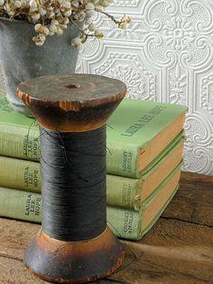 Vintage wood spool with black thread. $10.00, via Etsy.