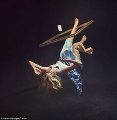 Topsy turvy: Helen shares another shot of her falling through a picture frame, writing 'how I feel all the time'