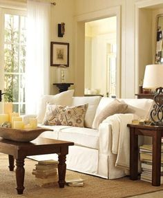 pottery barn living room @Jami Harris.....color on walls with white couches