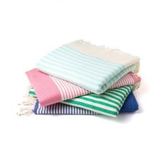 We are obsessed with these Fouta throw blankets - ideal beach blanket or even table cloth.
