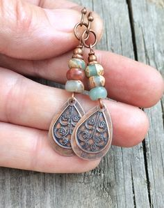 "Small copper filigree teardrops with African opals. These earrings are very light weight and are perfect colors for autumn! Approx 1.75"" in length."