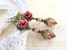 Victorian Rose - Dusty resin rose earrings with hand-cast resin roses and antiqued brass filigreee. Victorian style jewelry by ArdentHearts