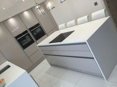The BA Components Zurfiz UltraGloss Cashmere kitchen doors used here by Purple Kitchens in Liverpool. A very modern and clean design. Kitchen Room Design, Modern Kitchen Design, Home Decor Kitchen, Kitchen Interior, Kitchen Designs, Kitchen Ideas, Open Plan Kitchen Dining Living, Open Plan Kitchen Diner, Kitchen Vinyl