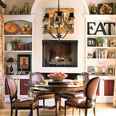 Raise the Fireplace    This dining room fireplace is raised to table height so it can be enjoyed by everyone in the room. AND BOOKS!!!   | SouthernLiving.com