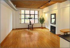 #RichmondMews #Lofts, #Toronto Toronto Lofts, Hardwood Floors, Flooring, Wood Ceilings, Gas Fireplace, Entryway Tables, Locker Storage, The Originals, Furniture