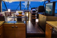 """Narrow window mullions provide a great view out of the Tiara 50 Flybridge's windows. When not in use, the 40"""" LCD TV drops into the cabinet with the push of a button."""