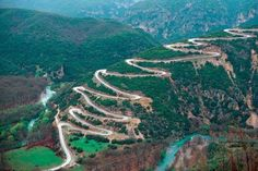 Some of the world's most scenic roads have series of hairpin turns climbing up and down the mountainside. A hairpin turn is a bend with a very acute inner angle, making it necessary for an oncoming vehicle to turn almost to continue on the road. Greece Tours, Greece Travel, Albania, Macedonia, Montenegro, Places Around The World, Around The Worlds, Dangerous Roads, Places In Greece