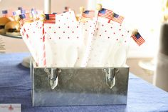Fourth of July Party | Heather Christo - wax paper sandwich bags with napkin, silverware & straw.