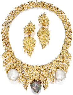 CULTURED PEARL DIAMOND NECKLACE AND PAIR OF MATCHING PENDENT EAR CLIPS, Gianmaria Buccellati. Suspending two baroque white cultured pearls and a baroque black cultured pearl, to a bib necklace set with carved gold feathers, set with rose-cut diamonds together weighing approximately 16.00 carats, length approximately 385mm; and a pair of matching pendent ear clips, the diamonds altogether weighing approximately 4.00 carats.