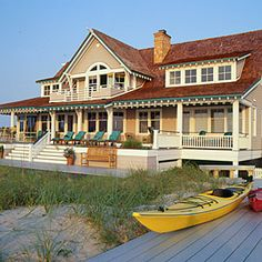 2002 Idea House: Family Reunion | Built to Last | CoastalLiving.com  -  love this porch! It's built for enjoying the perfect view as well as beachfront activities. Sip your coffee in the morning sunrise or entertain guests under the sunset and stars.
