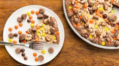 Irresistible fudgy brownie pizza swirled with peanut butter cream cheese and topped with peanut butter candies!