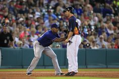 Texas Rangers third baseman Adrian Beltre tags out Houston Astros first baseman Brett Wallace during the fifth inning at Minute Maid Park.