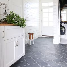 Slate Floor, White Cabinets, Butcher Block Counter, White Shiplap Walls