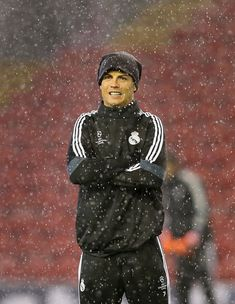 LIVERPOOL, ENGLAND - OCTOBER 21: Cristiano Ronaldo of Real Madrid CF reacts as it rains during a training session at Anfield on October 21, 2014 in Liverpool, United Kingdom. (Photo by Alex Livesey/Getty Images)