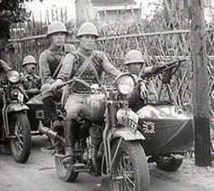 Japanese motorcycles with machine gun armed sidecars.