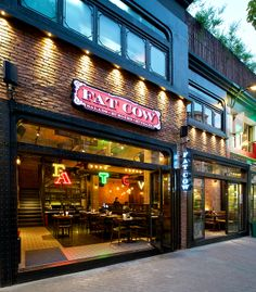 Fat Cow is a burger, steak and salad concept. Designed to be playful modern and industrial as well as a comfortable environment. Located on the popular street, Laowai Jie, Shanghai China. By RED Design Consultants. via Behance Burger Restaurant, Restaurant Design, Burger Bar, Fat Cow, Chilled Beer, Brewery Design, Burger Places, Pub Crawl, Shop Fronts