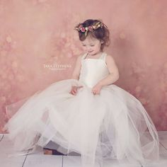 Our McKenna Dress is the perfect tutu dress for flower girls or photoshoots. Can be made in any color, see our color chart. Corset bodice ties in back. Default Length: Tea Length (If you need full len