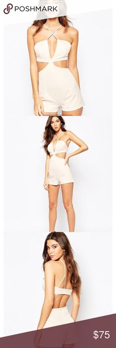 "NaaNaa Cut Out Plunge Romper UK SIZE 6.                                            Lightweight woven fabric  Plunge neckline  Inner gripper tape  Slim cross-over straps  Cut-out detailing  Hook and eye fastening to reverse Zip back closure  Regular fit - true to size Machine wash 100% Polyester Our model wears a UK 8/EU 36/US 4 and is 176 cm/5'9.5"" tall ASOS Pants Jumpsuits & Rompers"