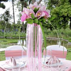 Wedding centerpiece with pink orchids... so dreamy!
