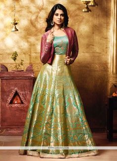 You will be the center of attention in this attire. Style and trend will be at the peak of your beauty when you attire this Jennifer Winget green banarasi silk floor length anarkali suit. The zari, la...