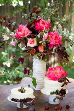 Decorating sweets table with fresh, seasonal fruit and fruit tree branches, and bouquets of flowers, candles...