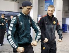 Real Madrid's Cristiano Ronaldo and Manchester United's Nemanja Vidic walked together towards their respective dressing rooms after arriving at the Bernabeu