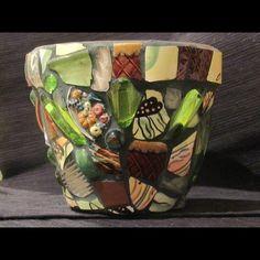 Mosaic flower pot; artist unknown