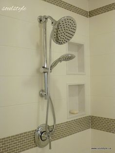 """8""""x20"""" soft white matte subway tiles were used on the walls, complemented by a soft taupe rectangular glass mosaic.  Quartz was used inside and to frame the wall niches."""