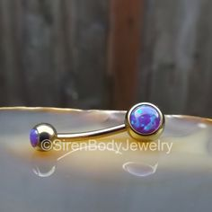 Titanium curved barbell with purple opals, love this! $29.99 Opal belly button ring rose gold titanium anodized internally threaded vch hypoallergenic 14g curved barbell purple fire opals navel rings by SirenBodyJewelry on Etsy