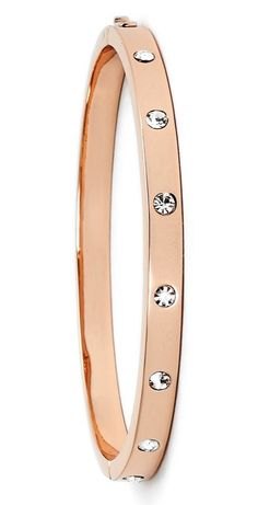 In love with this rose gold Kate Spade bangle with crystals that lend glamorous sparkle to the wrist. This could easily be worn alone or stacked for a variety of looks.