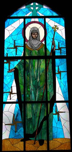 Beautiful stained glass window of St. Bridget (Brigid), in St. Bridget Catholic Church of Dayton, Tennessee.