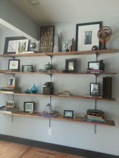 Easy DIY shelves for craft room. Instead of buying book shelves, hang rows of separate shelves. Home Depot has them already cut and stained.