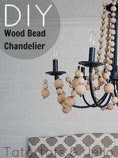 DIY Wood Bead Chandelier from TatertotsandJello.com #diy #chandelier