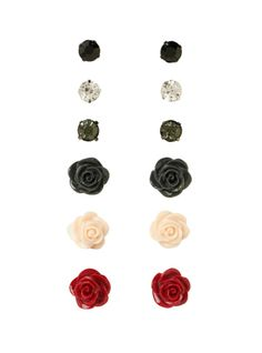 Six pairs of earrings with gem and rose detailing.