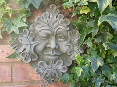 Winking Green man wall plaque