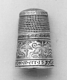 "German silver thimble dated 1577 in the Met and via their website. Posy reads: ""zier leib unnde mich mer ist beidte ir err"" [on the website this is rendered, 'If you adorn your body and me, we are both honored']"