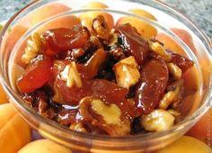 Такой рецепт мне поведала подруга. Раньше я и не подозревала что грецкие орехи тоже можно консервировать на зиму вместе с абрикосами. Это варенье отлично подходит к чаю и бутерброд...