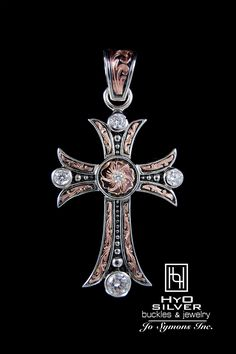 Cherish an enduring symbol of faith in the Western Monarch Cross Pendant. Sterling Silver and 1/10th 10k Rose Gold with Cubic Zirconia. Height: 2 1/4 in. Width: 1 3/4 in. Click here for our Chain Ordering Guide. This item is non-customizable.