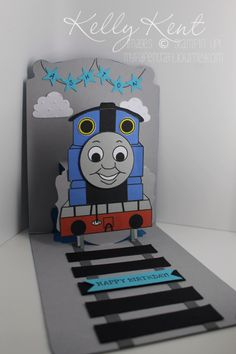 I will often match a birthday card with the theme of the party or invite. Ashton's birthday invite had a Thomas the Tank Engine theme, so I wanted to try my version of a Thomas Pop n Cut… Thomas Birthday Parties, Thomas The Train Birthday Party, Trains Birthday Party, Kids Birthday Cards, Diy Birthday, Train Party, Boy Cards, Kids Cards, Thomas And Friends