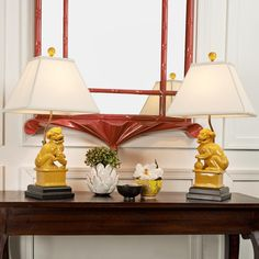 "Pair of Chinese Foo Dog Table Lamps 4 colors Chinese guardian lions, also known as Foo dogs, have always been the symbol of family wealth and social status. In Turquoise, Celadon, Ivory, or Mustard Yellow, you'll surely find a spot for a pair! Ivory rectangular pyramid shade. 3-wayy 100 watts. (23""Hx13""Wx10""D)"
