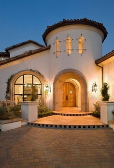 Lighting does wonders for the architecture. Flagstone walkway, roses and ivy - Spanish Exteriors