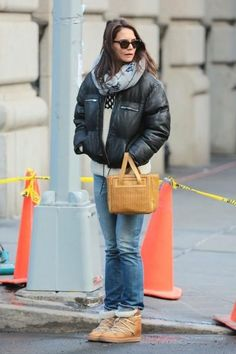 Katie Holmes wearing Isabel Marant Nowles Boots, Zac Posen x Brooks Brothers Bag and Isabel Marant Etoile Breyson Leather Puffer Jacket