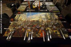 carla celestino 'miracolosamente' Le nozze di Cana del veronese, riprodotto su tessuto fa da fondale alla cena, servita su piatti trasparenti, affinché si abbia la sensazione di mangiare direttamente sul quadro...