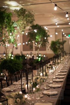 Subdued and elegant dining space. Wedding decor trend for 2014: Choose lush leaves over flowers! - Wedding Party