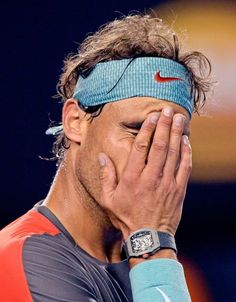 Rafael Nadal of Spain reacts after losing a point to Stanislas Wawrinka of Switzerland. (Andrew Brownbill/AP)